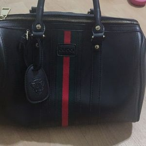 Black Gucci satchel